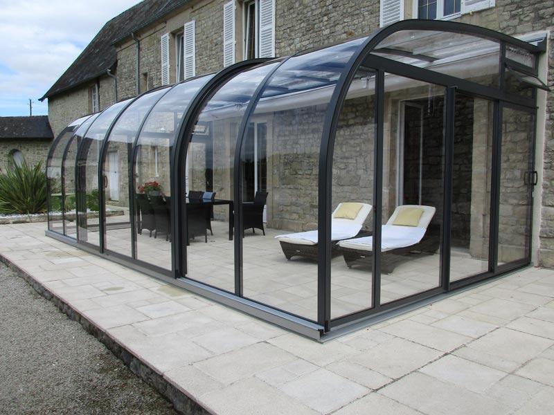 Abris extens abris voroka pour terrasse piscine en alsace for Constructeur piscine alsace